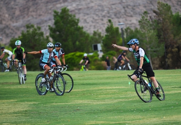 Las Vegas Cyclo-Cross member Brian Larson, right, leads the group on a course while training at Red Ridge Park, near Durango Road and Arby Avenue. (Chase Stevens/Las Vegas Business Press) Follow C ...