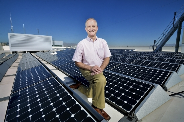 Tom Axtell, general manager of Vegas PBS, is shown with one of the solar panel arrays on the roof of the station at 3050 E. Flamingo Road. (Bill Hughes/Las Vegas Business Press)