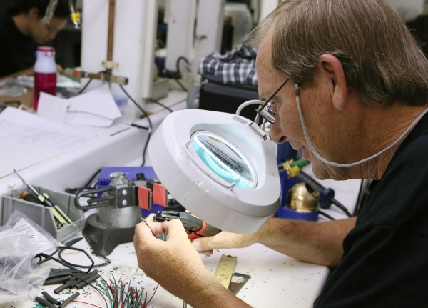 Richard Hatcher works in the manufacturing facility at Kiesub Electronics. (Ronda Churchill/Las Vegas Review-Journal)