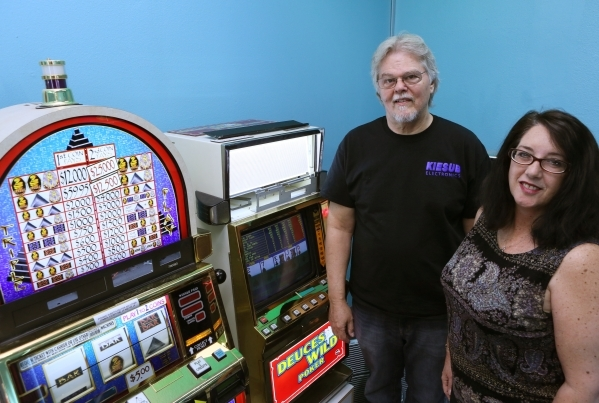 Mike Johnsen, director of manufacturing, and Margie White, director of marking, show off slot machines containing LED edge-lit panels produced by Kiesub Electronics in Las Vegas. (Ronda Churchill/ ...