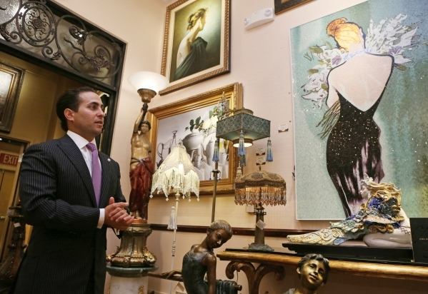 General manager Ike Dweck gives a tour of an upstairs showroom at Regis Galerie located inside the Grand Canal Shoppes at The Venetian on July 24. A Christopher Guy mozaic is shown hanging at far  ...