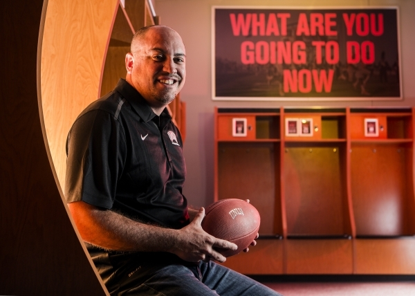 New UNLV football coach Tony Sanchez, shown in the Lied Athletic Complex locker room, has embraced the marketing aspects of his new job. JEFF SCHEID/LAS VEGAS BUSINESS PRESS