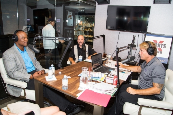 From left, Green Bay Packers' cornerback Damarious Randall and  Hall of Fame quarterback Warren Moon talk with Sports X Radio's Ken Thomson during a program July 27 from the studio  at ...