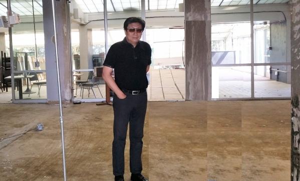 Las Vegas-based real estate eveloper John Yang checks out progress on a senior housing facility he's developing in Alabama. COURTESY PHOTO