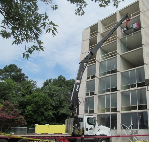 Crews work to convert a former hotel in Birmingham, Ala., into a senior housing facility being developed by Las Vegas-based real estate developer John Yang. COURTESY PHOTO