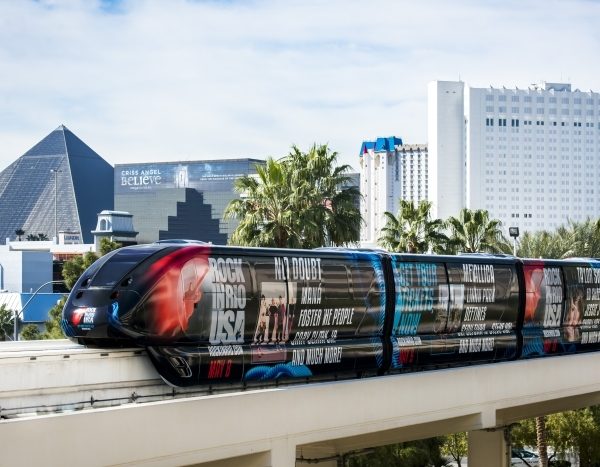The monorail moves north from the MGM station with Luxor and Tropicana in the background. (Courtesy Las Vegas Monorail Co.)