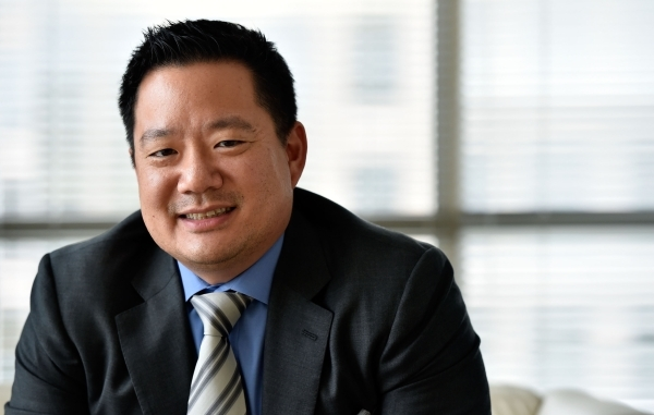 Kai-Shing Tao, CEO of Remark Media, sits in his Las Vegas office on Tuesday, Aug. 25, 2015. Remark Media, a digital media company focusing on the 18- to 34-year-old age group, recently acquired th ...