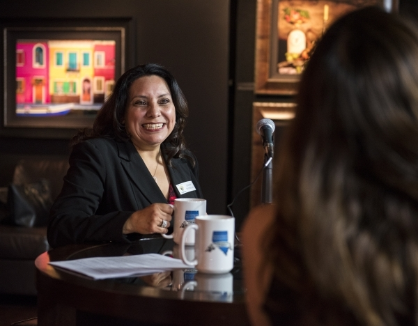 Laura Nowlan, left, President of See Us Now Staffing, speaks to Alicia G. Herrera during a video shoot for the Nevada Hispanic Business Group at the William Carr Gallery at Tivoli Village in Las V ...