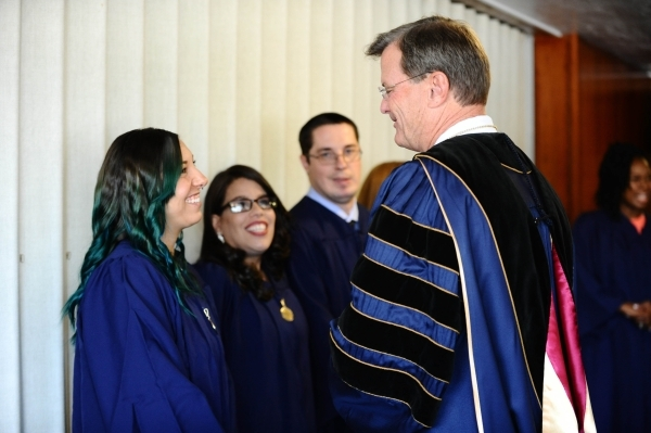 Andrea Petty, left, talks with WGU President Robert Mendenhall at the commencement exercies recently in Salt Lake City. Between them are Iraida Guadalupe (Brooklyn, N.Y.) and Chris Cox (Atwater, C ...