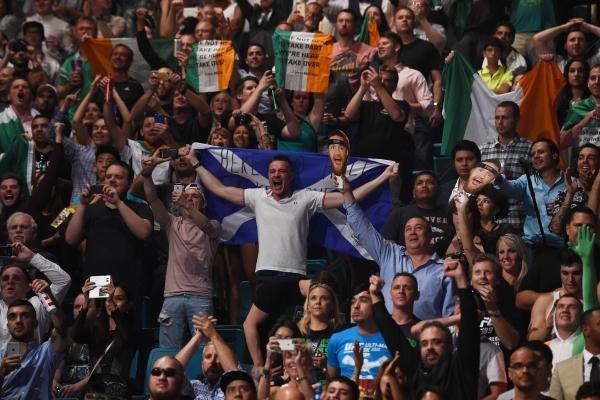 Fight fans cheer during UFC 189 Saturday, July 11, 2015 at the MGM Grand Garden Arena in Las Vegas, Nevada. CREDIT: Sam Morris/Las Vegas News Bureau