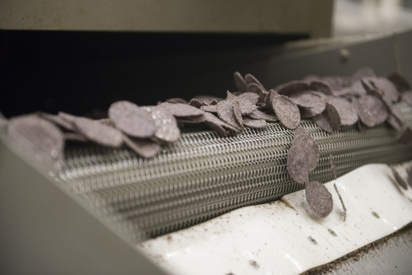 Baked chips leave the oven at the RW Garcia plant at 4780 N. Lamb Blvd. in Las Vegas Wednesday Sept. 2, 2015. (Jason Ogulnik/Las Vegas Review-Journal)