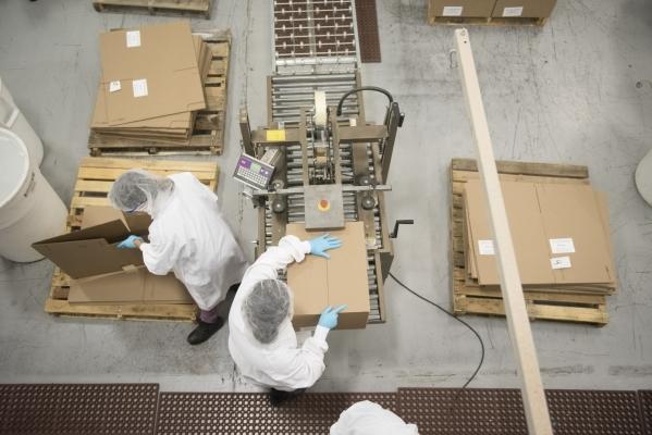Employees box chips at the RW Garcia plant at 4780 N. Lamb Blvd. in Las Vegas Wednesday Sept. 2, 2015. (Jason Ogulnik/Las Vegas Review-Journal)
