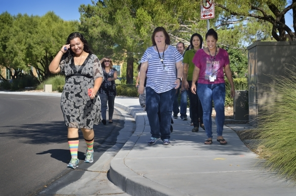 Billing department employees from HealthCare Partners Nevada walk during a break from the office at 650 White Drive on Wednesday, Sept. 9, 2015. Bill Hughes/Las Vegas Review-Journal