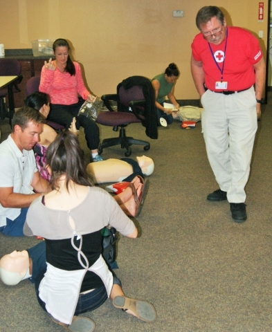 Scott Emerson, CEO of the American Red Cross, Southern Nevada chapter, instructs a class on the technique for chest compression. (Garrison Wells, Business of Medicine)