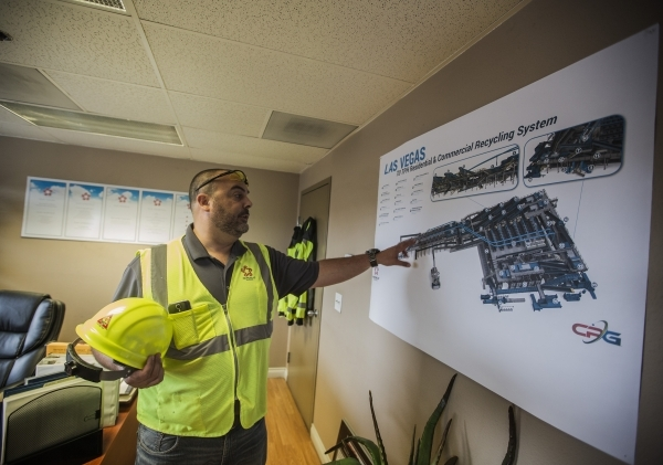 Len Christopher, general manager of Republic Services, shows a diagram of the Southern Nevada Recycling Complex, 333 West Gowan Road, North Las Vegas, on Tuesday, Sept.15, 2015. Republic Services& ...