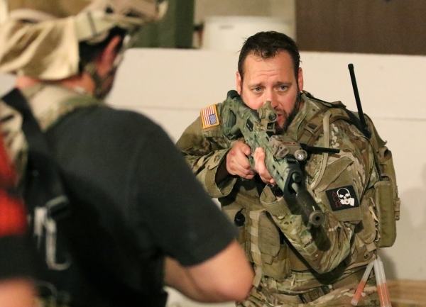 Operative Neptune gives instruction during a training exercise at Adventure Combat Ops Tuesday, June 30, 2015, in Las Vegas. Adventure Combat Ops allows people to learn about basic tactical concep ...