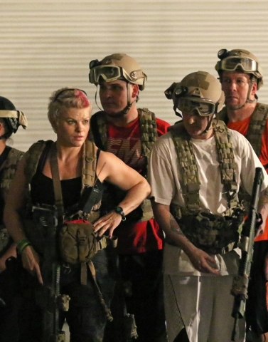 Operative Jax, left, watches her trainees perform during an exercise at Adventure Combat Ops Tuesday, June 30, 2015, in Las Vegas. Adventure Combat Ops allows people to learn about basic tactical  ...