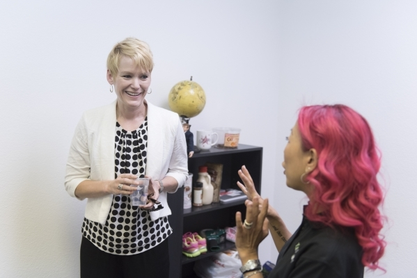 Sarah Brown of FranNet, left, speaks with co-owner of a local 101 Mobility franchise, Michele Kim-Andres, in Kim-Andres' office in Las Vegas Monday, Sept. 28, 2015. Jason Ogulnik/Las Vegas R ...