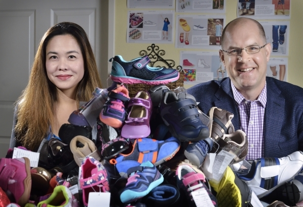 Angela Edgeworth, founder and president of Pediped Footwear, and Rudy Glocker, managing partner, are shown at company headquarters at 1191 Center Point Drive in Henderson on Thursday, Oct. 8, 2015 ...