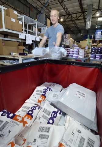 Scott Boehm, internet packing manager at Pediped Footwear, is shown filling orders in the company warehouse at 1191 Center Point Drive in Henderson on Thursday, Oct. 8, 2015. (Bill Hughes/Las Vega ...