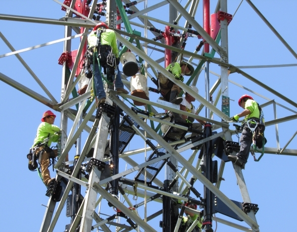 An Ampjack America crew works on raising the height of a power transmission tower without a crane and without disrupting service. (Courtesy, Ampjack America)  Undated, October, 2015