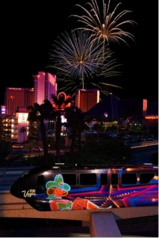 Fireworks explode over the Strip marking the new year as the Monorail moves revelers between parties. (Courtesy Las Vegas Monorail)