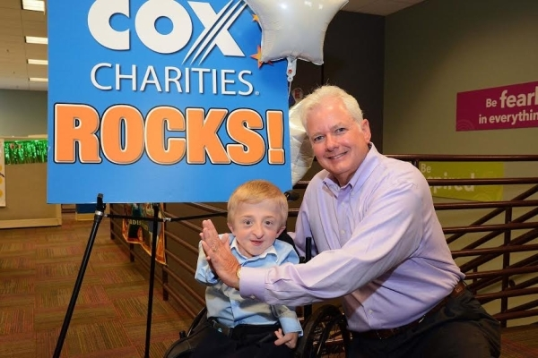 Cox Las Vegas vice president and market leader, Michael Bolognini (right) doubled Best Buddies' $5,000 grant to $10,000 after learning more about the organization and meeting local ambassado ...