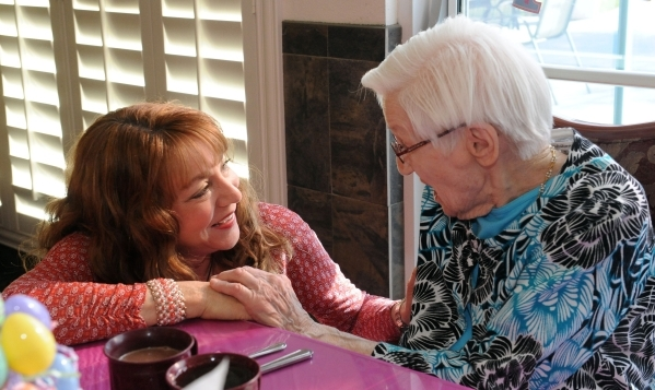 Kathleen Edwards, left, talks to Edna Hauser at Hauser's 102nd birthday celebration at Willow Creek Assisted Living in Las Vegas, Monday, April 7, 2014. (Jerry Henkel/Las Vegas Review-Journal)