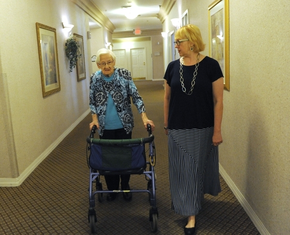 Activities Director Brenda Dawley, right, escorts Edna Hauser to Hauser's 102nd birthday celebration at Willow Creek Assisted Living in Las Vegas, Monday, April 7, 2014. (Jerry Henkel/Las Ve ...