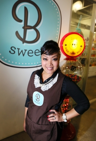Arlene Bordinhao, co-owner of B Sweet Candy Boutique, stands outside B Sweet Candy Boutique Friday, Nov. 6, 2015, in Las Vegas. The local sweets shop and catering business headquarters is located  ...