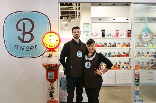 Victor Bordinhao, left, and his wife Arlene, owners of B Sweet Candy Boutique, stand outside B Sweet Candy Boutique Friday, Nov. 6, 2015, in Las Vegas. The local sweets shop and catering business  ...