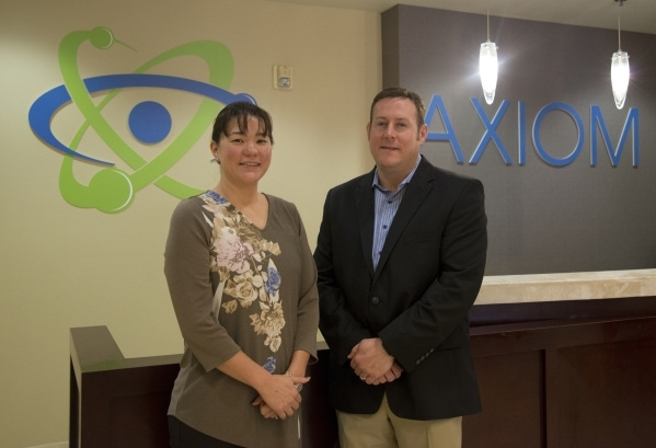 Founders Shannon, left, and Troy Wilkinson, are seen inside the main office of Axiom Consulting Services in Las Vegas on Tuesday, Nov. 10, 2015. Their company specializes in cyber security solutio ...