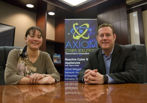 Founders Shannon, left, and Troy Wilkinson, are seen in the conference room inside the main office of Axiom Consulting Services in Las Vegas on Tuesday, Nov. 10, 2015. Their company specializes in ...