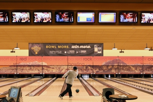 A bowlers plays near a Rolltech banner at Red Rock Lanes Friday, Nov. 13, 2015, in Las Vegas. Las Vegas-based Rolltech presents Action Bowling, a platform where bowlers around the country can conn ...