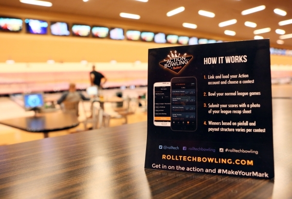 An advertisement for Action Bowling is shown on a table at Red Rock Lanes Friday, Nov. 13, 2015, in Las Vegas. Las Vegas-based Rolltech presents Action Bowling, a platform where bowlers around the ...