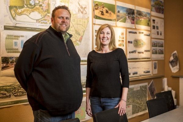 Lee Farris, left, vice president of land development, and Cheryl Persinger, vice president of marketing, pose for a photo at the Landwell offices in Henderson, Nev. on Tuesday, Nov. 24, 2015. Josh ...