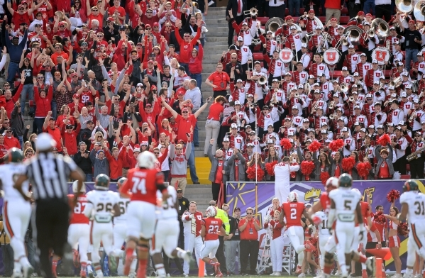 Dec 20, 2014; Las Vegas, NV, USA; Utah Utes fans cheer as running back Devontae Booker (23) rushes for a touchdown against the Colorado State Rams during the first half of the Las Vegas Bowl at Sa ...