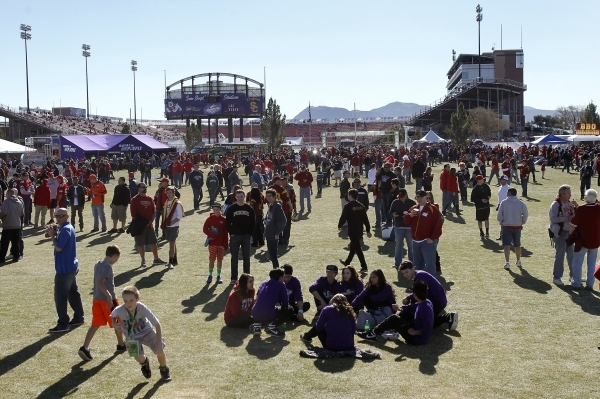 Fans tailgate and participate in pre-game festivities before USC takes on Fresno State at the Royal Purple Las Vegas Bowl at Sam Boyd Stadium in Las Vegas on Dec. 21, 2013. (Jason Bean/Las Vegas R ...