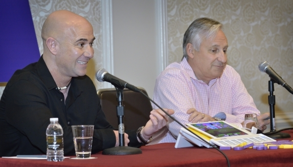 Andre Agassi, chairman and founder of the Andre Agassi Foundation for Education, left, and Andy Butler, CEO of Square Panda, are shown during a press conference announcing a partnership of the fou ...