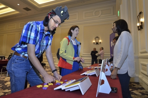 Jacob Elspas, a staff writer at Mommy Blog Expert, checks out the Square Panda phonics play-set at the Bellagio hotel-casino in Las Vegas on Monday, Jan. 4, 2016. Square Panda is an education tech ...