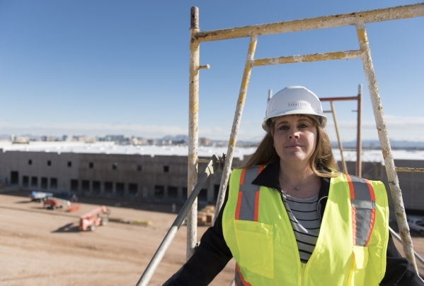 Christina Parker, development manager with Panattoni Development, poses at Panattoni Development's industrial project site at the intersection of West Sunset Road and South Jones Boulevard i ...