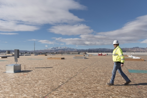 Charlie Rushing, superintendent with Alston Construction, gives a tour of Panattoni Development's industrial project site at the intersection of West Sunset Road and South Jones Boulevard in ...