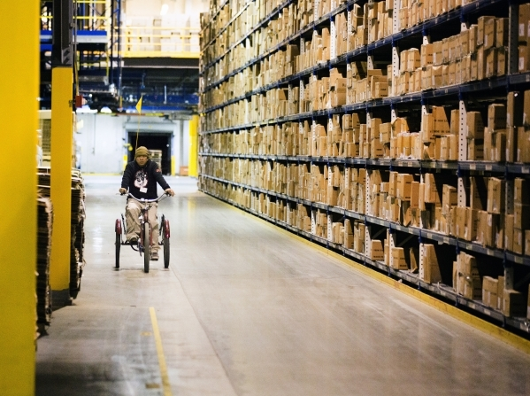A man bicycles in the  Levi Strauss & Company's Sky Harbor Distribution Center, 501 Executive Airport Drive, in Henderson on Thursday, Jan. 7,2016. The one million square foot  distribut ...