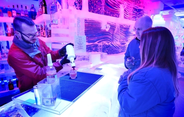 Bartender Kyle Adams, left, mixes a drink for Chris Maupin, center, and Lindsey Perry at the Minus5 Ice Bar in The Shoppes at Mandalay Place at 3930 Las Vegas Blvd. S. on Friday, Feb. 5, 2016. Bil ...