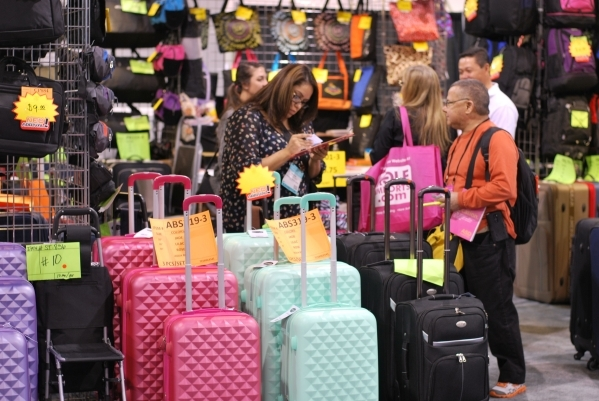 Retail buyers prowl the luggae aisles at a 2015 ASD Market Week. (Courtesy)