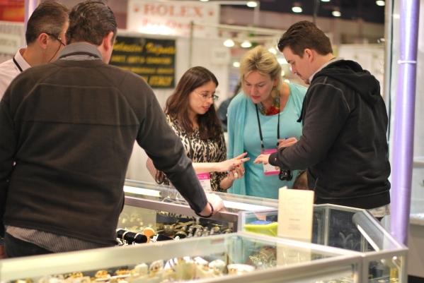 Retail buyers examine jewelry at a 2015 ASD Market Week. (Courtesy)