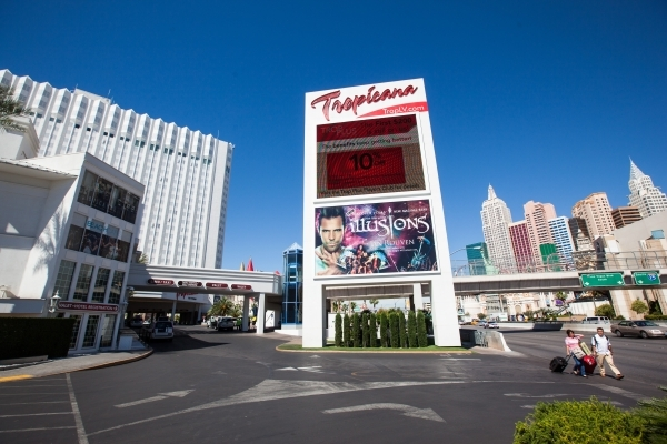 People pass by the Tropicana hotel-casino in Las Vegas on Wednesday, April 29, 2015. Penn National Gaming announced an agreement to acquire the Tropicana for $360 million. (Chase Stevens/Las Vegas ...