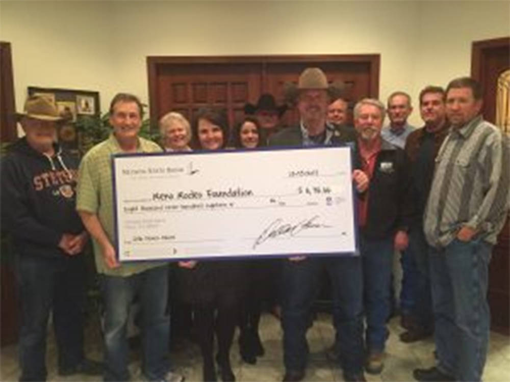 Nevada State Bank's Debby Herman presents check to the Reno Rodeo Foundation. (Courtesy)