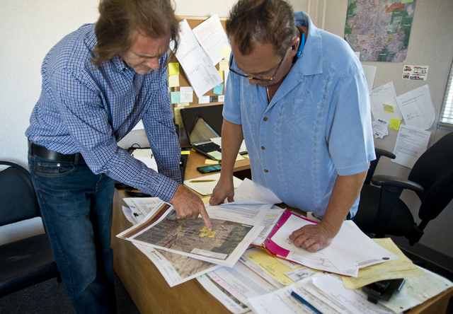 Ron Krater, left, and Peter Price look over a map of the site of a proposed community at the Blue Diamond Hill Gypsum mine near the town of Blue Diamond on Thursday, Aug. 11, 2016. Daniel Clark/La ...