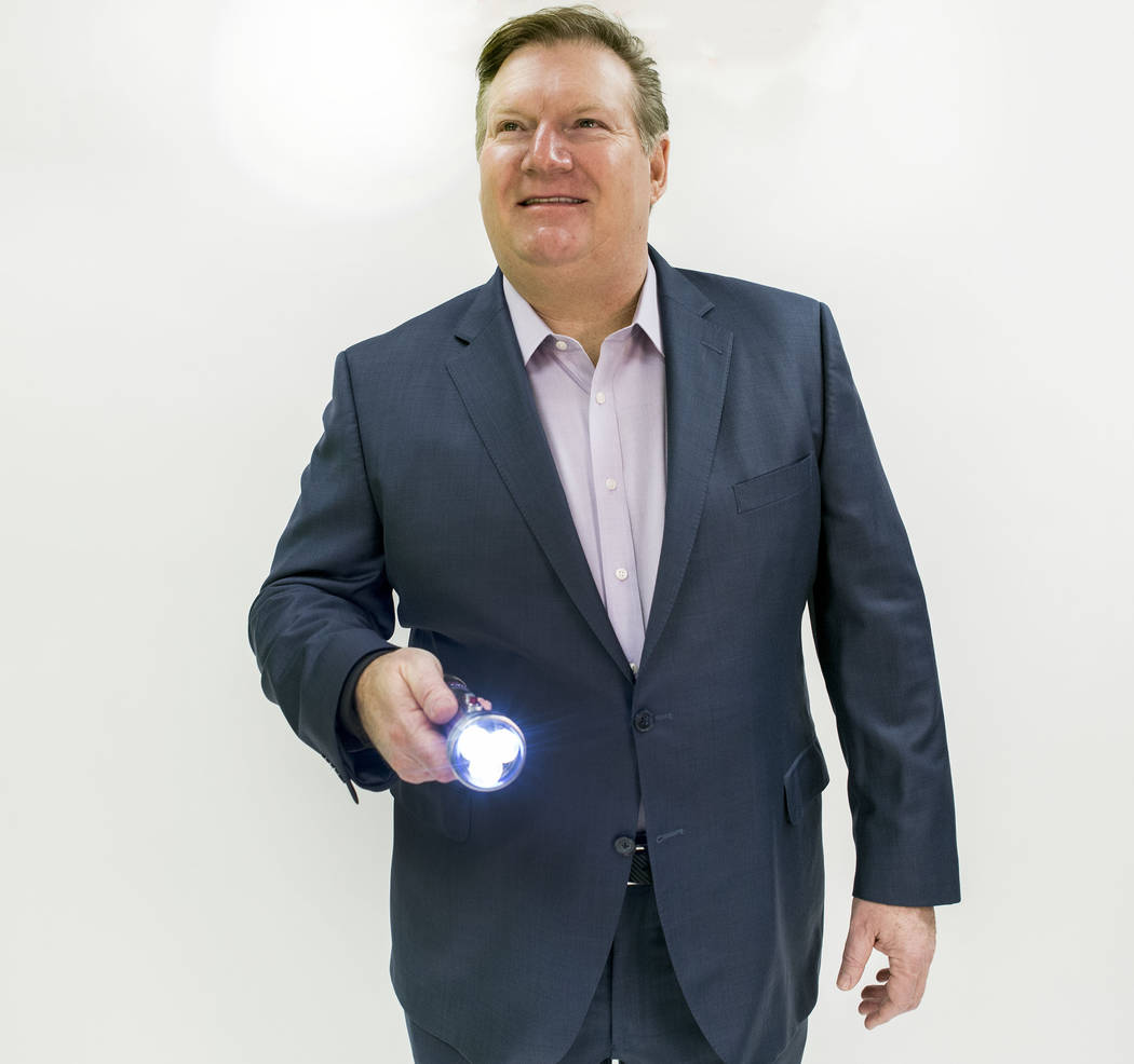 Goettl Air Conditioning owner Ken Goodrich holds his company's signature flashlight at the Las Vegas Review-Journal photo studio, Las Vegas, Tuesday, Feb. 28, 2017.  (Elizabeth Brumley/Las Vegas R ...